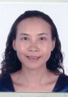 A photo of Ping, a tutor from Yunnan Normal University