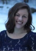 A photo of Elisha, a tutor from Framingham State University