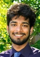 A photo of Neel, a tutor from Mills College