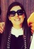 A photo of Roxanne, a tutor from Southwestern University