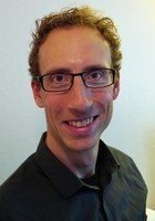 A photo of Mark, a tutor from Carleton College