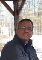 A photo of Mark, a tutor from Syracuse University