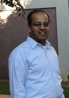 A photo of Venkat, a tutor from Andhra University India
